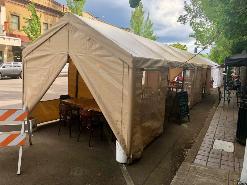 Downtown tents in parking spaces